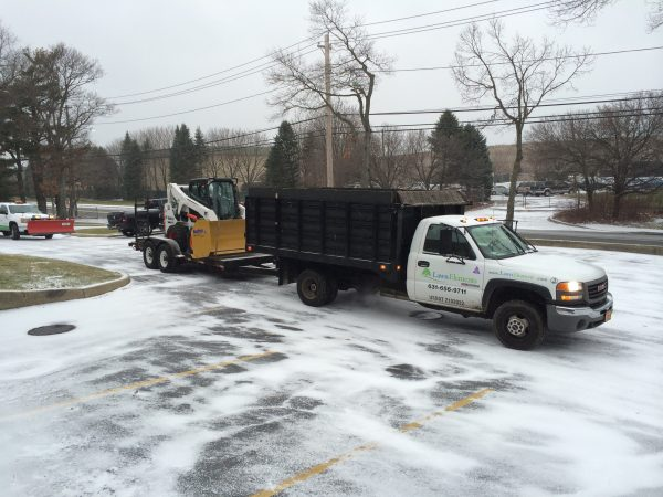 snow removal truck and tractor