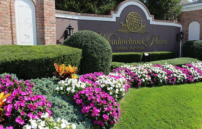 meadowbrook pointe sign with flowers