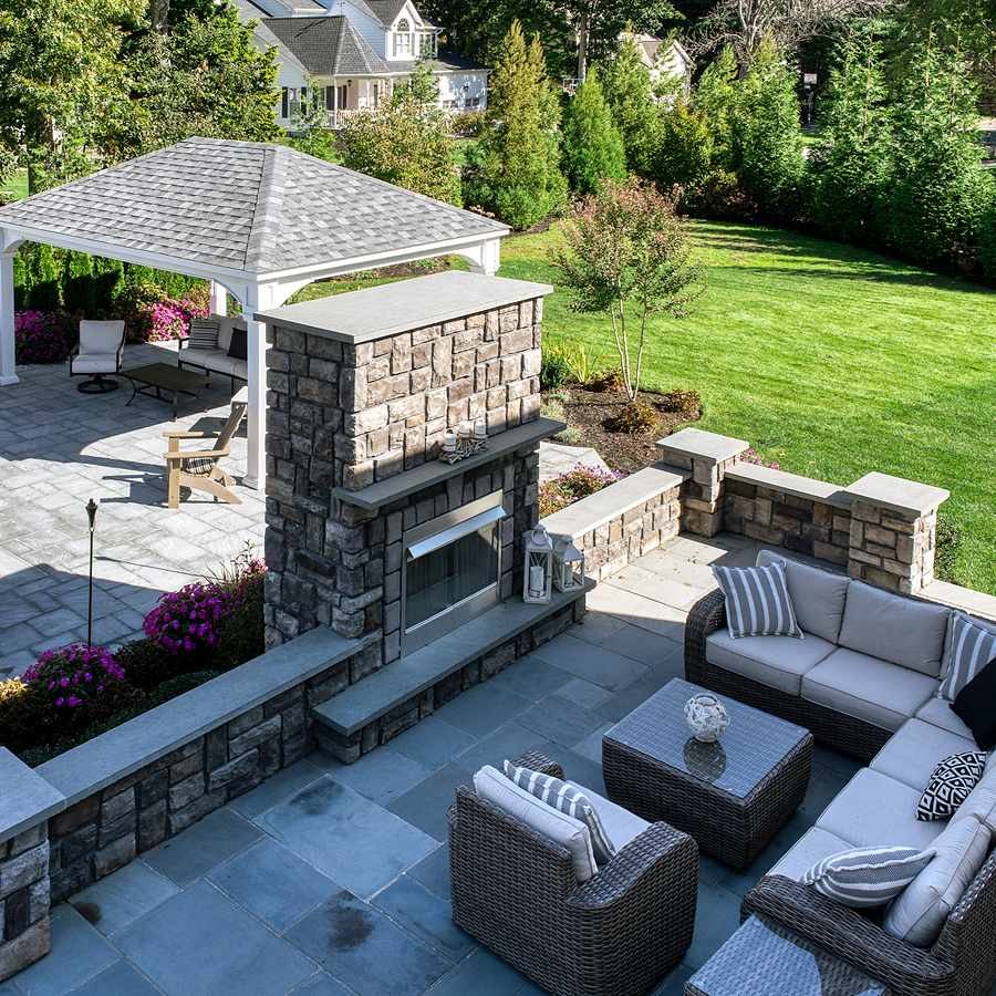 backyard fireplace and dining area