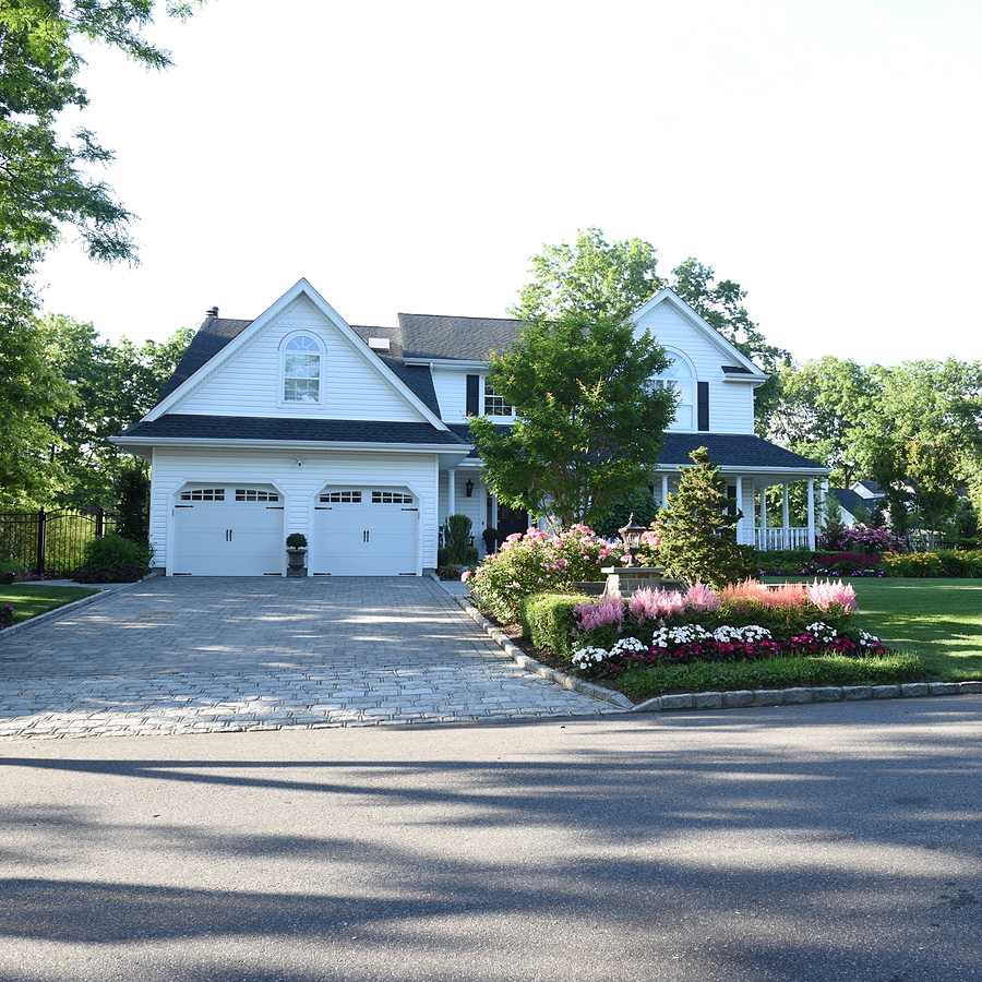 driveway and landscaped front yard