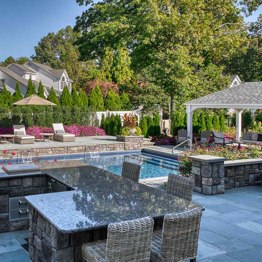 pool and dining area in back yard