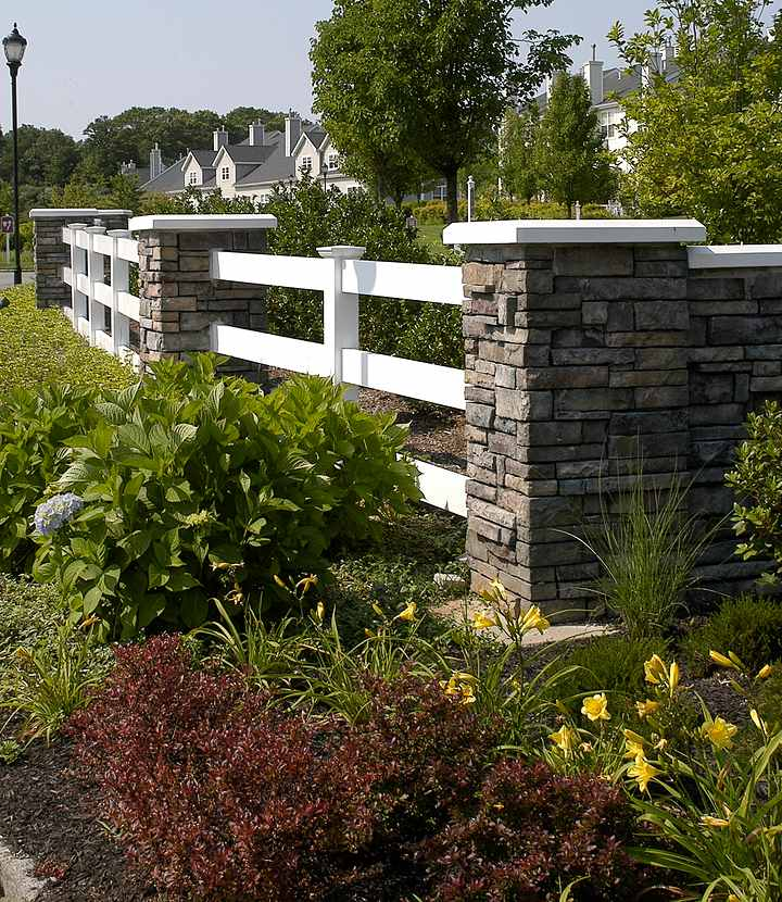 stone fence with landscaping
