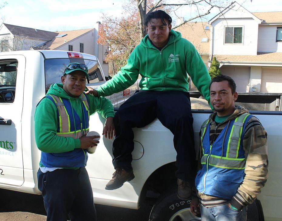 lawn elements team members sitting on truck