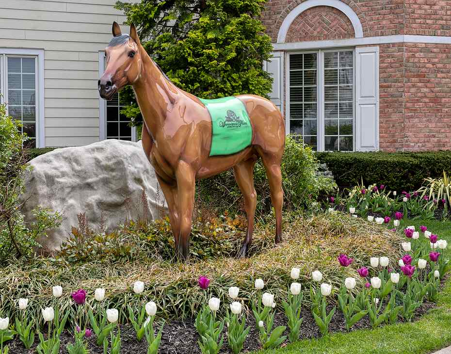 horse sculpture surrounded by flowers