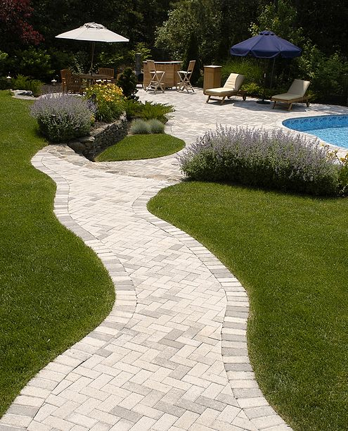 curved walkway leading to pool