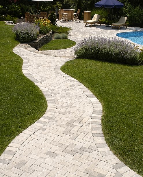 curved paver walkway to pool