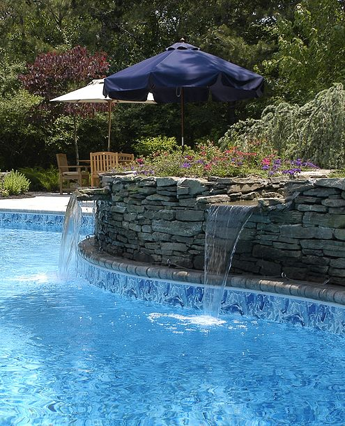 back yard pool with water fall